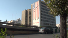 Iran Tehran 'Down with the USA' flag depicting bombs skulls hatred politics Stock Footage
