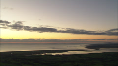 Aerial magic hour along estuary and coast Stock Footage