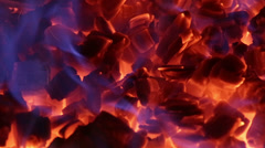 Hot ember glowing with blue flames - seamless loop Stock Footage
