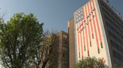Tehran, Iran, famous government building with American flag Stock Footage