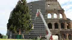 Colosseum in Rome next to newly erected Christmas tree Stock Footage
