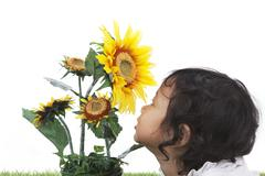 baby with flowers - stock photo