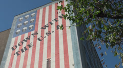 Iran, American flag, painting, Down with USA, skulls and bombs Stock Footage