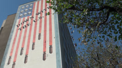 Iran, American flag depicted with skulls and bombs on government building - stock footage