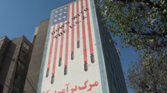 Famous anti American painting on building in Tehran, Iran, Middle East - stock footage