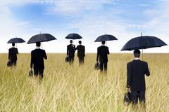 Stock Illustration of businessmen with umbrella outdoor