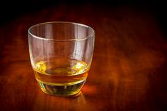 Whisky or rum on a wooden table Stock Photos