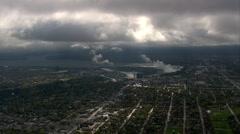 Wide aerial shot Niagara Falls in distance spray Stock Footage