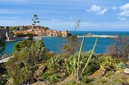 Stock Photo of mediterranean vegetation with sea and a village