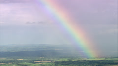 Rainbow over countryside - stock footage
