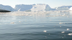 Driving through ice in arctic waters on a sunny day Stock Footage