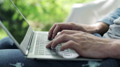 man's hands  typing on a laptop - stock footage