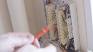 Stock Video Footage of Telephone engineer checking lines