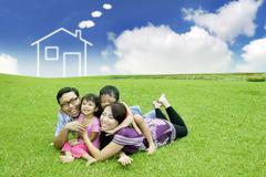 Young asian family with a dream house on the field Stock Illustration