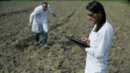 Stock Video Footage of couple of scientists working with tablet in the field