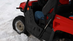 A family drives a four wheeler in the snow Stock Footage