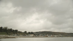 Winter storm-clouds over Lyme Regis, Dorset UK. Time-lapse Stock Footage
