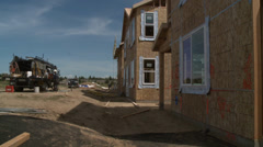 HOUSE NEW HOME CONSTRUCTION IN SUBURBAN ECONOMIC RECOVERY Stock Footage