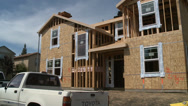 Stock Video Footage of HOUSE NEW HOME CONSTRUCTION IN SUBURBAN ECONOMIC RECOVERY