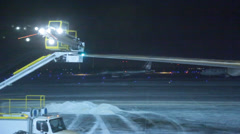 De-icing Truck Backs Away from Plane Stock Footage