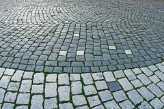 Cobblestone sidewalk made of cubic stones 2 Stock Photos