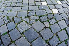 Cobblestone sidewalk made of cubic stones 10 Stock Photos