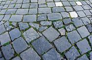 Stock Photo of cobblestone sidewalk made of cubic stones 10