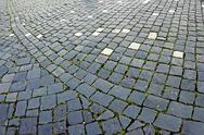 Stock Photo of cobblestone sidewalk made of cubic stones 9