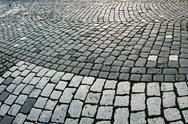 Stock Photo of cobblestone sidewalk made of cubic stones 8