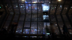 Tourists aerial view of Shanghai night-scene in huanqiu sightseeing hall. Stock Footage
