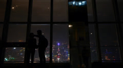 Tourists aerial view of Shanghai night-scene in huanqiu sightseeing hall. - stock footage