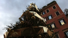 Nicely decorated tree with Rome building in background (dolly shot) Stock Footage
