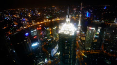 Aerial view of skyscraper with river in Shanghai at night,Chin,panorama shot. Stock Footage