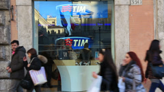 Italians pass by TIM telephone store Stock Footage