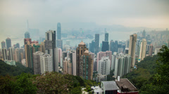 Time lapse of Victoria Harbour and Tsim Sha Tsui from Victoria Peak, Hong Kong Stock Footage