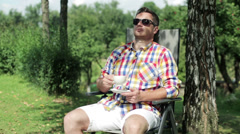 Man drinking coffee in the garden Stock Footage