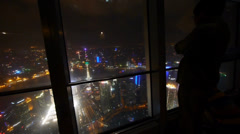 a man aerial view of Shanghai night-scene from skyscrapers windows. - stock footage