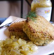 Crab cakes and green tomato chow relish Stock Photos
