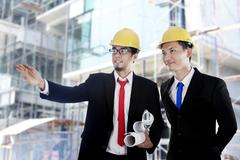 Asian businessmen at construction site Stock Photos