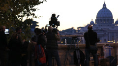 Film crew in Rome capture starlings in flight Stock Footage