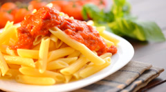 Pasta Penne with Bolognese Sauce, Parmesan Cheese and Basil Stock Footage