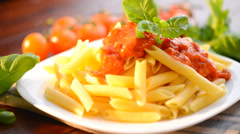 Pasta Penne with Bolognese Sauce, Parmesan and Basil. Pasta Dish Stock Footage