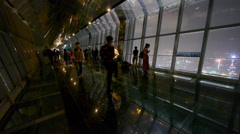 people silhouette in huanqiu sightseeing hall,aerial view of urban night-scene. - stock footage
