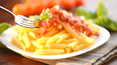 Pasta on a Fork. Pasta Penne with Bolognese Sauce - stock footage