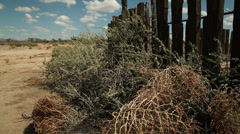 Tumbleweeds abandoned ranch ghost town desert #2 Stock Footage
