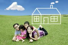 Stock Illustration of happy family with dream house
