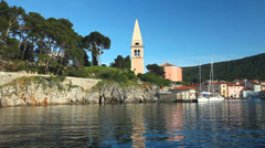 LOSINJ - JUNE 16: Sailing boat entering harbour on the island of Losinj on June Stock Footage