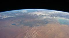 International Space Station in earth orbit, crossing over Japan Stock Footage