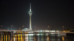 Time lapse of the Macau Tower and Macau-Taipa Bridge at night Stock Footage