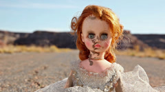 Doll abandoned road dirty girl #1 Stock Footage